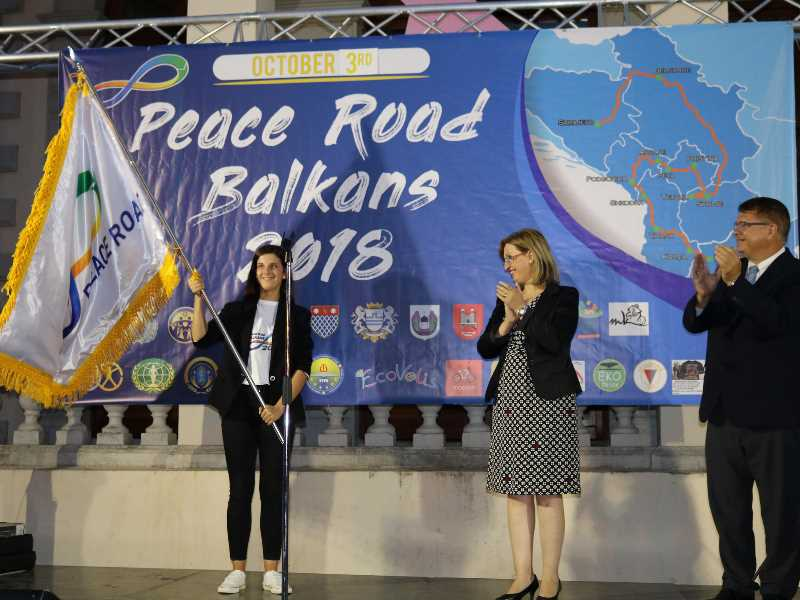 Balkan Peace Road - Passing the Peace Road Flag